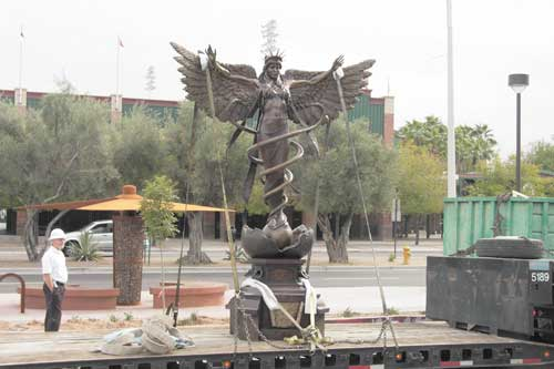 Caduceus bronze sculpture monument being installed Scottsdale Arizona